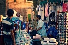 Street vendor (The Wolf) Tags: street people italy rome roma sunglasses italia hats shirts streetvendor dwcffstreet