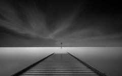 Silent Skies (paulantony2) Tags: converging jetty horizon darkskies blackandwhite longexposure sea