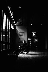 Parked at Östra Hamngatan (FreakyLeo) Tags: life street city light shadow bw sun man window sign contrast dark nordstan göteborg sweden parking wheelchair gothenburg hard shoppingmall sverige sv svartvitt femman hamngatan rullstol canon5dmarkii powmerantusenord tokinaatx24200mmf3556 afatx242