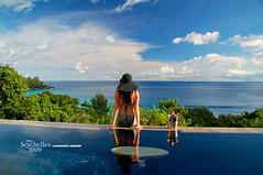 Luiza, Seychelles (Dan & Luiza from TravelPlusStyle.com) Tags: woman infinity horizon resort seychelles infinitypool sunhat banyantreehotel infinityedgepool vanishingedgepool negativeedgepool disappearingedgepool zeroedgepool