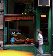 passing moustache (omoo) Tags: newyorkcity green restaurant yellowcab westvillage moustache storefront greenwichvillage middleeastern bedfordstreet dinersinthewindow newyorkwomanwalking parentswithchildren justdownthestreetfromchumleys