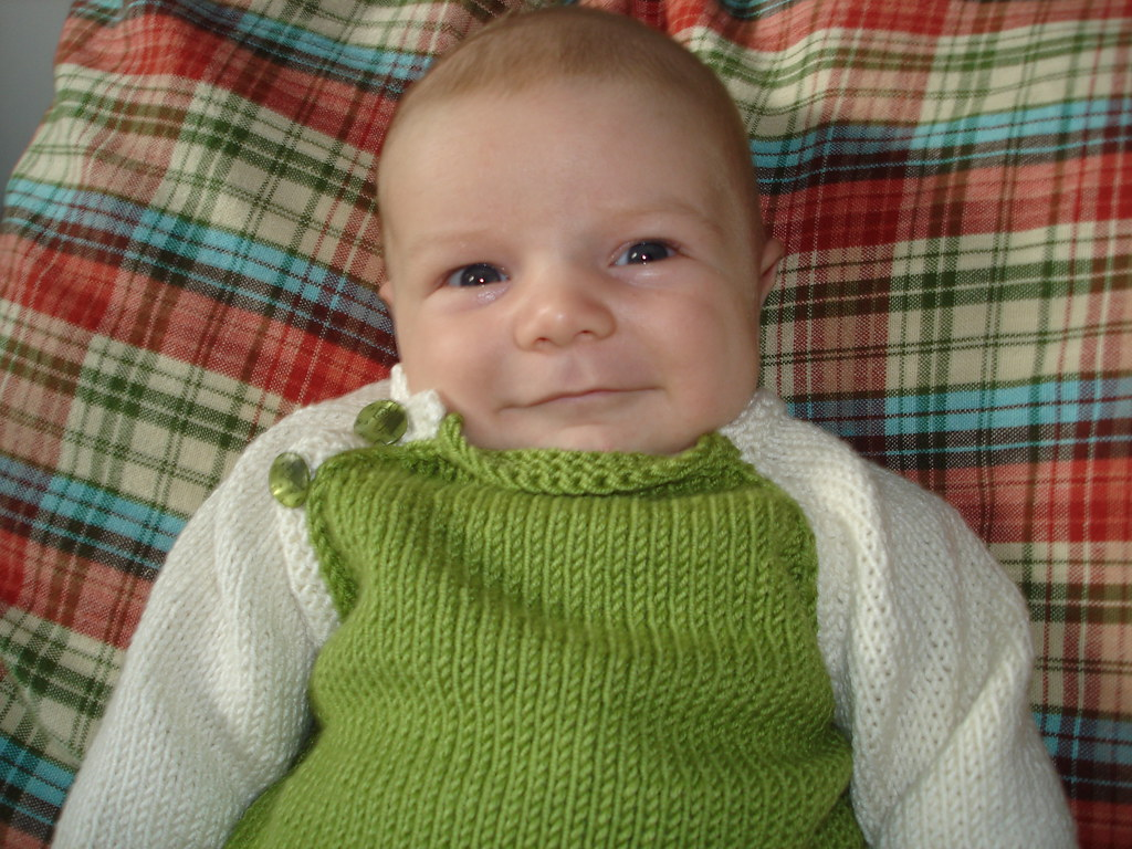 Proud of his Mommy's knitting skillz