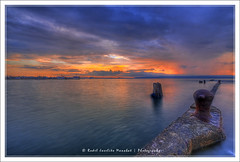 Whooped Sunrise ([ Rodelicious ]) Tags: ocean longexposure trip travel blue light sea vacation sky sun seascape color colour reflection art beach nature beautiful beauty smile clouds contrast photoshop sunrise canon landscape geotagged photography photo rocks exposure dof photos philippines wharf pk canoneos hdr highdynamicrange davao hdri blending waterscape rodel sigma1020mm mabuhay photomatix kadayawan tonemap colorphotoaward impressedbeauty aplusphoto pinoykodakero canon40d colourartaward perfectescapes rodelicious ifolio garbongbisaya rodeljoselitomanabat gettyimagesphilippinesq1 gettyimagesasia gettyimagesphilippines