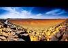 Sahara (dani.Co) Tags: africa red sky panorama orange sahara yellow rock clouds sand nikon desert angle stones dunes wide wideangle arena marocco desierto marruecos 1224 merged d300 cs4 fpg danco flickrslegend