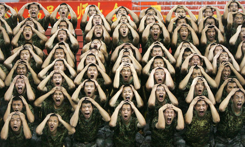 Troops perform during a rehearsal of The Road of Revival, a musical drama to be staged as part of national celebrations marking the 60th anniversary of the founding of the Chinese Communist state