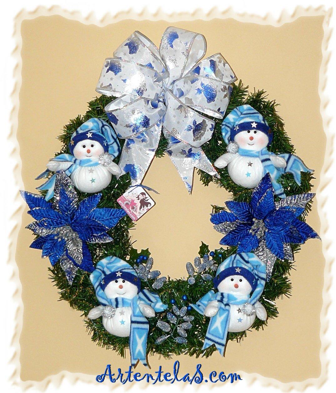 ... de dejarles esta corona navideña de hombrecitos de nieve que acabo de