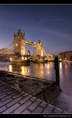 Tower Bridge ~ London ~ England (Hasselbach Photography) Tags: city uk travel bridge blue light sunset vacation england sky urban holiday reflection building london tower history tourism monument water beautiful stone thames skyline architecture night clouds towerbridge reflections river dark landscape lights twilight dock europe long exposure downtown cityscape lift slow symbol britain dusk district united famous capital great dramatic kingdom landmark center tourist panoramic business backpack historical late drawbridge british iconic hdr attraction thegherkin ryanhasselbach hasselbachphotography