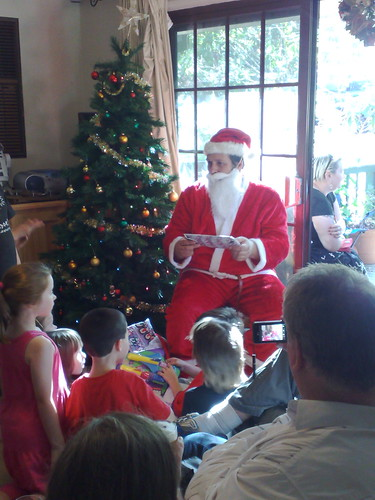 Santa handing out the pressies
