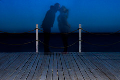 the forgotten kiss 1 (PDKImages) Tags: shadows ghosts love kiss beauty not there story looking memories waiting searching disappeared disappearing firstkiss lastkiss silhouettes hooded wishing monochrome sea coast waves blues blue lost palomarenaissance sky turkey
