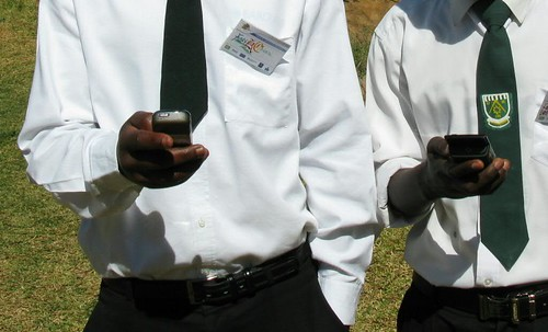 Zambian learners on their mobile phones (Source: Steve Vosloo, CC-BY-NC-SA)
