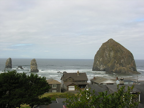 Haystack Rock with beach homes
