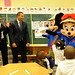 Principal Zipporah Hightower, Ron Huberman, Mickey and Minnie greet Pre-K students