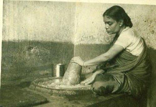 Lady grinding chutney