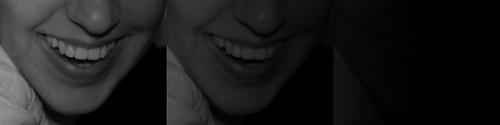 tres frames en fade out (fundido) a negro de una sonrisa