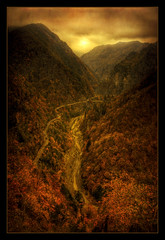 Haunted place (Kugarth) Tags: road wood autumn light sunset shadow red sky favorite orange cloud brown sun mountain black color colour tree green texture nature water beautiful beauty yellow rock fog digital forest photoshop canon river dark landscape photography eos photo leaf high nice interesting pretty view dynamic image stones branches hill vivid cliffs haunted romania frame land fav 1785mm range hdr highdynamicrange comment faved arges 17mm transfagarasan peisaj cetate 40d poenari canoneos40d dragondaggerphoto dragondaggeraward magicunicornverybest magicunicornmasterpiece