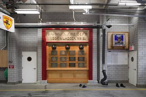 The wall of fallen heroes was preserved from the previous firehouse. ()