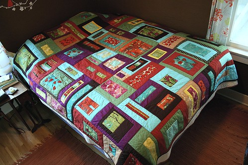 Lantern Bloom Quilt on Bed