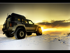 Into The Light (Leo Druker) Tags: light sunset orange sun snow cold car weather sunrise volcano lava iceland highlands jeep bright 4wheeldrive fourwheeldrive lavarocks superjeep polarsun mthekla mounthekla icelandwinter nikond3 heklavolcano icelandhighland icelandvolcano polardays 4wheeldrivecars winterhighlands icelandhighlandwinter