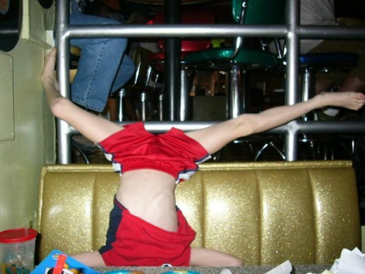 OH JESUS FUCKING CHRIST! Are you really letting your kid do barefooted headstands at the table in a restaurant? At this point its the PARENTS that deserve to be spanked. This is bullshit!