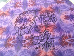 embroidered collage outline on purple