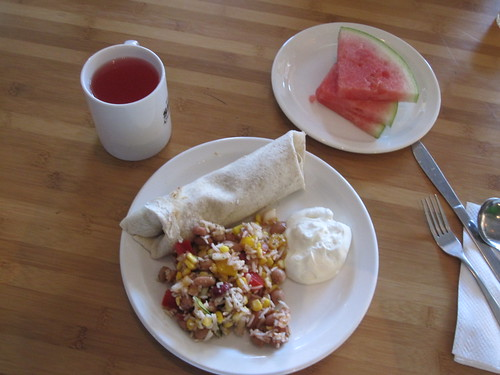Burrito, sour cream, rice salad, melon, lemonade - $6