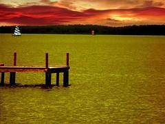 burning (Eisgrfin (very busy)) Tags: red nature water germany boat wasser heaven himmel steg abendrot niedersachsen segelboote steinhudermeer goldstaraward worldwidelandscapes natureselegantshots eisgrfin theoriginalgoldseal peregrino27newvision