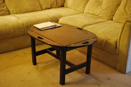 Polished brown wood sofa table