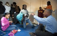 NASA Administrator Bolden Volunteers with the DC Cares Program (200912140007HQ) (NASA HQ PHOTO) Tags: students washingtondc nasa santasworkshop dccares billingalls charlesbolden parkviewrecreationcenter
