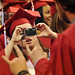 Graduate takes a photo of friends.