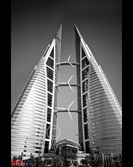 21/52 - Bahrain World Trade Centre (.:shk:.) Tags: building architecture island centre muslim islam towers middleeast twin business arab trade manama shk windturbines kingdomofbahrain bwtc bahrainworldtradecenter bahrainwtc canoneos500d  shkarim sogirkarim sogskarim  albahrayn bahraintowers