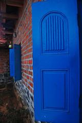 ... Darkly, Deeply, Beautifully Blue ... ~ Lord Byron (Mind's Peephole) Tags: blue red window bricks dakshinchitra nikond40