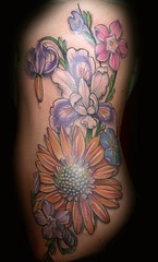 flowers tattoo on the ribs (maliareynolds) Tags: flowers atlanta iris yellow tattoo female georgia purple sunflower memorialtattoo maliareynolds