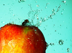 An apple a day... (photon tamer) Tags: plant color macro apple nature water fruit germany interestingness colours sony flash herbst fast explore splash alpha waterdrops 700 raindrop highspeed strobe fastshutter anappleaday autumnfruits explored strobist