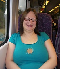 Pardon me boy is this the train that goes to Hull? (Brassy Lassy) Tags: blue smiling train star glasses sitting boobs top relaxing tshirt lipstick sat hull topheavy milf spectacle satsitting traintohull