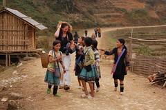 Village children selling to a foreigner