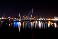 SA1SailBridge (andyathlon) Tags: light motion reflection water swansea night marina reflections boats lights long exposure nightshot sony sigma sainsburys 1020 sa1 technium sailbridge a700