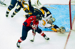 Morrison Blurred Between the Legs (clydeorama) Tags: usa ice hockey nhl washingtondc dc washington goal goalie buffalo shot caps icehockey center miller dcist puck morrison score verizon capitals sabres nationalhockeyleague verizoncenter rockthered