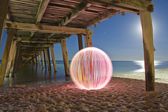 Ball of light - That Sinking Feeling (biskitboy) Tags: ocean lighting longexposure light sea lightpainting color reflection art beach beautiful night canon ball circle stars eos lights mirror golden photo sand long exposure nightlights photographer bright artistic dusk jetty orb balls australia sphere wharf round adelaide nightsky sa southaustralia canondslr 18200 grange bluemoon learner brightcolours lightart tennyson balloflight lightball startrail adelaidebeaches eos450d 450d grangejetty canon18200 canoneos450d denissmith 5dmkii 5dmk2 adelaidenight spherelightpainting colourbrightcolors