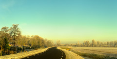 The black road. (Alex-de-Haas) Tags: 50mm d5 dutch hdr january nederland nederlands netherlands nikkor nikkor50mm nikon nikond5 noordholland thenetherlands warmenhuizen westfrieseomringdijk bevroren cityofwarmenhuizen cold daglicht daylight frozen gevroren handheld highdynamicrange icy januari koud landscape landschap licht light overdag polder polderlandschap sun sunray sunrays sunbeams sunny sunrise winter zon zonnestralen zonnig zonsopgang