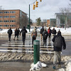 Eleven strangers cross a sloppy street in silence. (Tim Kiser) Tags: 019 11people 2016 20160302 capitalregion eastlansing eastlansingmichigan harrisonroad inghamcounty inghamcountymichigan lansingmetropolitanarea msu march march2016 michigan michiganstate michiganstateuniversity southharrisonroad bollard centralmichigan crossingastreet crossingthestreet crosswalk crosswalkstripes dirtyslush dirtysnow elevenpeople greenandwhite greenbollard midmichigan pedestriancrossing pedestriancrosswalk pedestriansignal pedestrians people phonepicture slop slush snow southcentralmichigan stoplights strangers students trafficlights trafficsignals walking walkingpeople wetpavement wetstreet winter winterslop unitedstates us