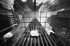 Apple in Big Apple (Philipp Klinger Photography) Tags: new york nyc trip travel windows light shadow vacation sky bw usa sun white ny black art luz sol apple lines architecture clouds facade america skyscraper geotagged us blackwhite store arquitectura nikon symbol geometry lumire united ciel cielo highrise states avenue nuage amerika brand 5th philipp bigapple sigma1224mm nube unis estados staaten klinger unidos etats vereinigte tats d700 bratanesque ostrellina dcdead