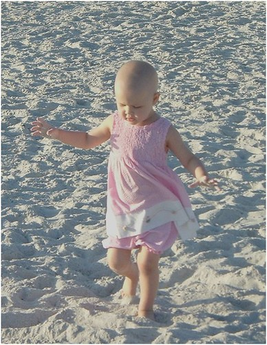 012107 adelaine bald head cancer child walking on beach