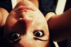 Compagni di viaggio - Myself         [Sott e 'ncopp] (Occhidaorientale [Mi votai all'inquietudine]) Tags: selfportrait self estate occhi puglia viso vacanze sera ragazza taranto sdraio atestaingiù occhidaorientale canoneos400d agosto2009 sotttosopra