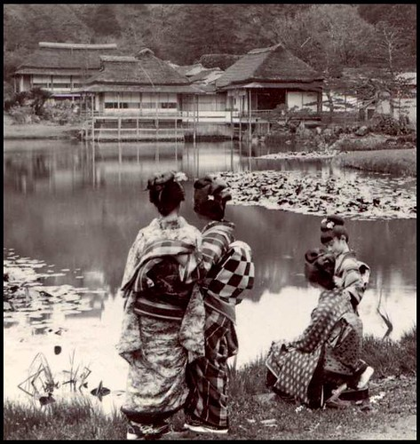 THREE GEISHA and a LITTLE GIRL BY THE POND in HIKONE PARK NEAR OLD KYOTO, JAPAN