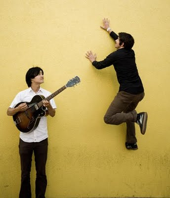 The Dodos once again in front of a wall doing stuff.