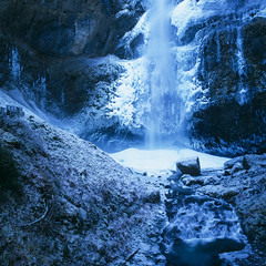 Multnomah Falls (Zeb Andrews) Tags: blue winter cold film ice nature oregon square landscape outdoors frozen waterfalls pacificnorthwest icy multnomahfalls columbiarivergorge extremeweather fujivelvia50 hasselblad500c bluemooncamera zebandrewsphotography theytookthiscameratothemoon andshotitinzeroatmosphere ibarelyworryaboutshootingin20degreeweather