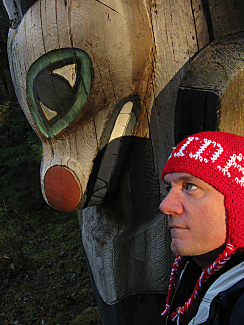 Otilius self portrait with totem pole, Kasaan Totem Park, Kasaan, Alaska