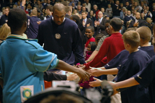 Kids from The Salvation Armys Shelter for Women and Children form the tunnel for the Butler Bulldogs.