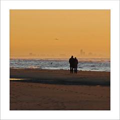 the two of us.. (leuntje) Tags: sunset beach strand zonsondergang couple scheveningen noordzee northsea noordwijk silhouets