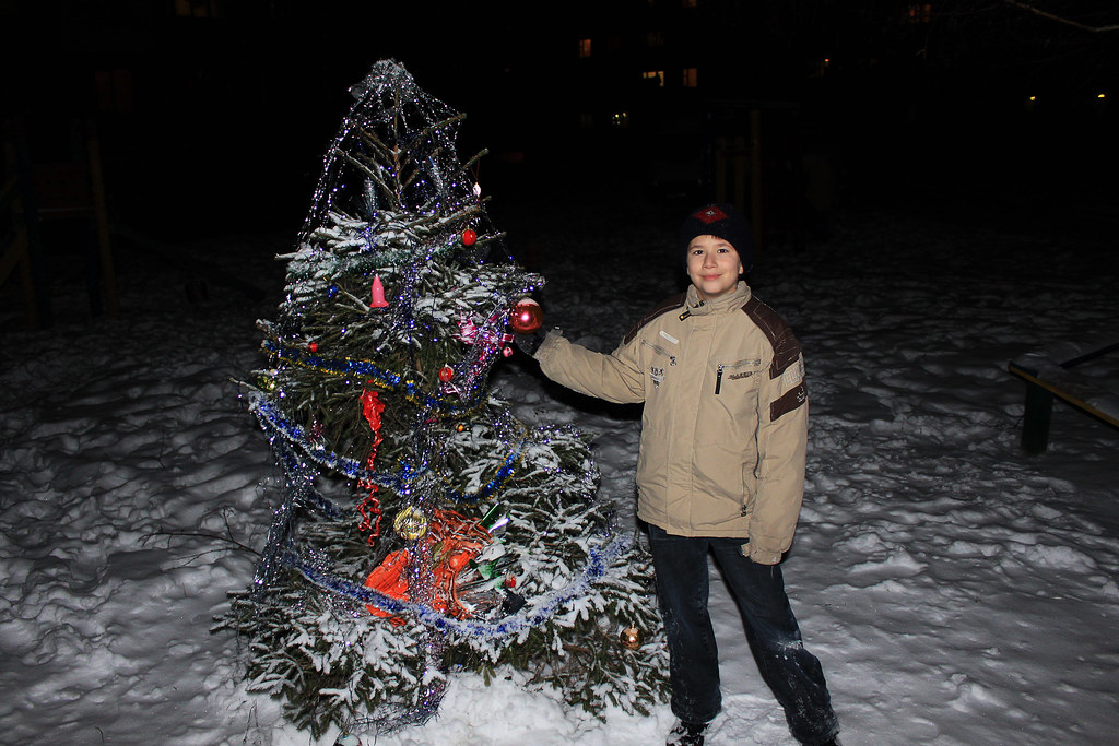 Joshua with a New Year Tree